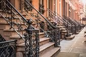 stock photo of brownstone  - Brownstone apartment building entrances in New York City - JPG