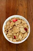 pic of cereal bowl  - cereals with dry fruits in white bowl on brown background - JPG