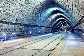 picture of tram  - Tunnel with railroad and tram at night - JPG