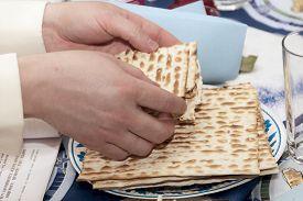 image of seder  - it is Matzen bread broken celebrating Seder Passover - JPG