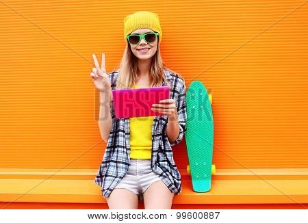Fashion And Technology Concept - Stylish Pretty Cool Girl With Digital Tablet Pc Having Fun In The C