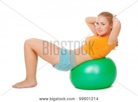 Young woman on gymnastic ball isolated