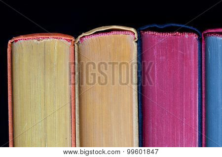 Colorful Books. Hard Cover. Black Background. Isolated