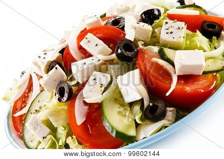 Greek salad on white background