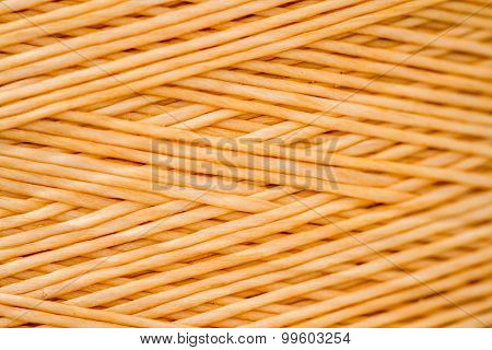 Close Up Of A Spool Of Synthetic Orange Thread