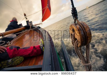 Traditional Wooden Boat with red sail. Detail.