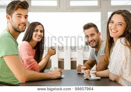 Friends having a great day at the local coffee shop