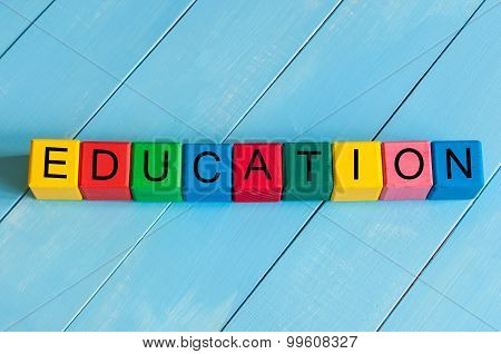Word Education on children's colourful cubes or blocks - educational background for teaching.