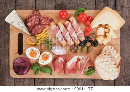 Prosciutto di Parma with olives and other italian antipasto food