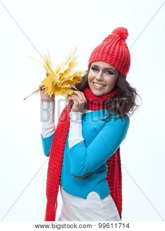 beauty young caucasian woman brunette in warm colorful clothing  with yellow autumn maple leaves smiling happy toothy smile face isolated on white studio shot