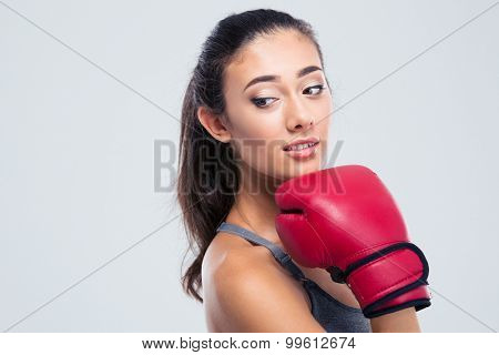 Portrait of a cute fitness woman with boxing gloves standing isolated on a white background