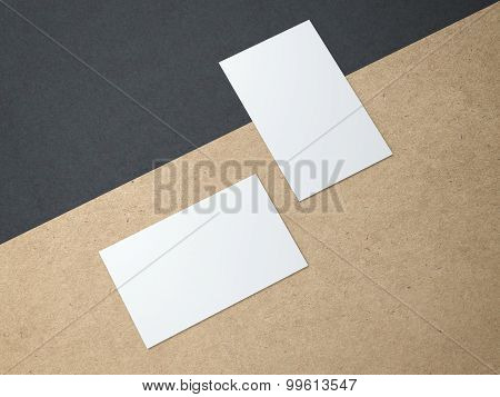 Two business cards on the kraft paper
