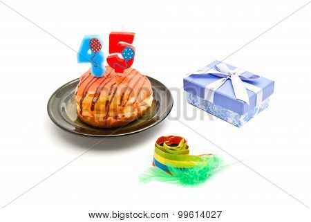 Donut With Forty Five Years Birthday Candle, Whistle And Gift On White