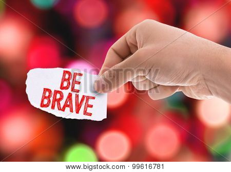 Piece of paper with the word Be Brave with bokeh background