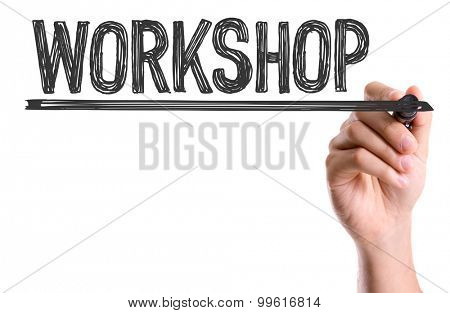 Hand with marker writing the word Workshop