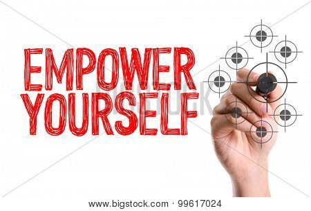 Hand with marker writing the word Empower Yourself