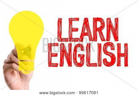 Hand with marker writing the word Learn English