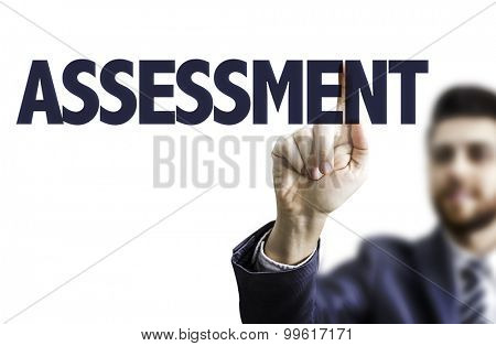 Business man pointing the text: Assessment
