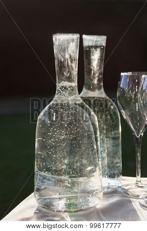 bottles of mineral water and glass