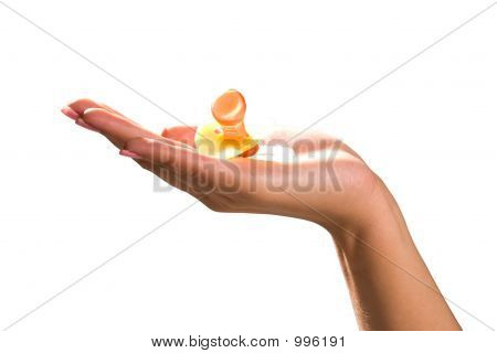 Hand Holding Pacifier