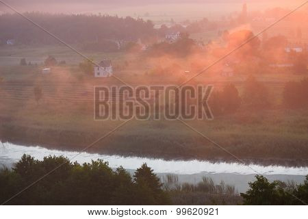 Morning landscape. Fog over the river in the rays of the rising sun. Ukraine, Europe