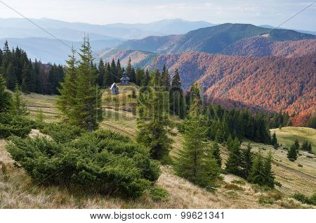 Old wooden church in the mountains. Autumn landscape. Carpathians. Ukraine, Europe