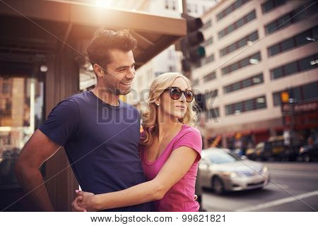 romantic couple on street corner in down town la