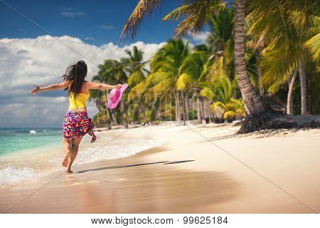 Carefree Young Woman Relaxing On Tropical Beach
