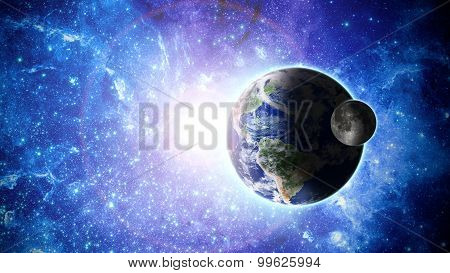 Planet Earth and moon in space