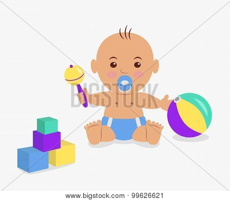 Cute baby  playing with a rattle and cubes.