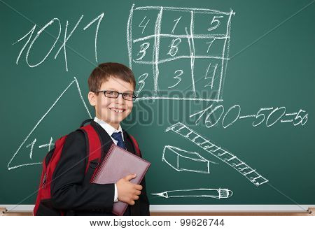school boy with drawing on board