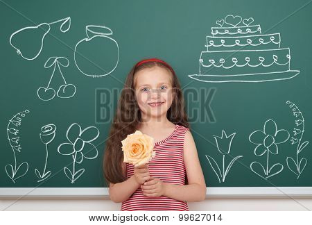 girl with draw flowers and other object on board