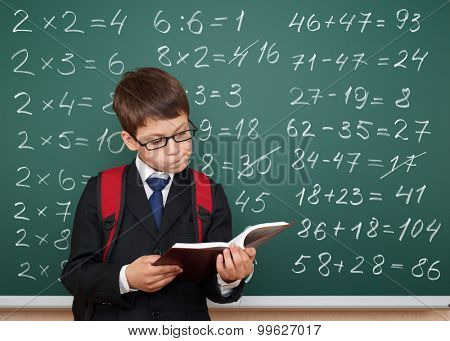 boy exercise math on school board