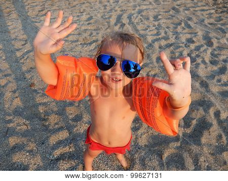 funny girl in sunglasses on summer beach