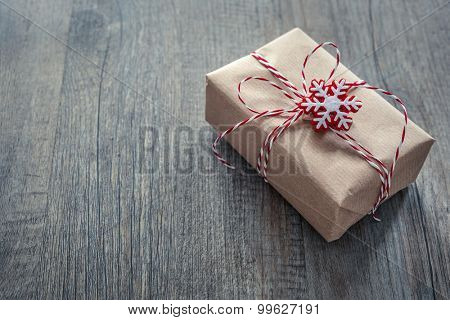 Christmas gift box over grunge wooden background