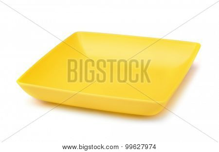 Yellow square plastic plate isolated on white
