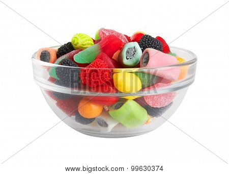 Sweet colorful candy in bowl, isolated on white background