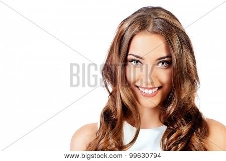 Beauty portrait of a positive young woman in white dress. Isolated over white background. Beauty, fashion. Cosmetics.
