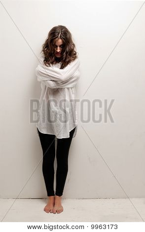 Young Insane Woman With Straitjacket Standing Looking At Camera