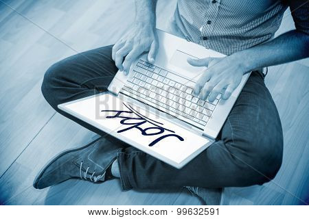 The word jobs against young creative businessman working on laptop