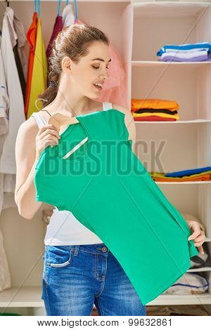 a girl is trying on clothes