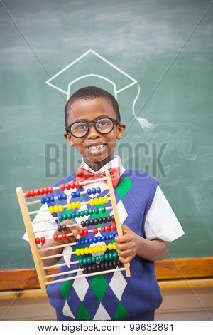 Graduation hat vector against smiling pupil holding abacus