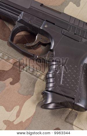 Handgun On Military Camo Bdu