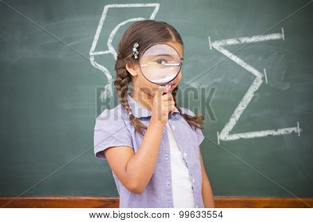 Sum symbol against pupil looking camera with magnifying glass
