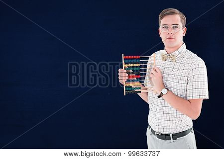 Geeky hipster holding an abacus against navy blue