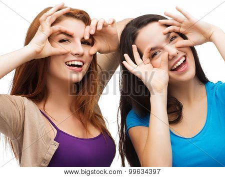 happiness and people concept - two young teenagers making funny faces