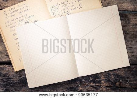Open School Notebook On Wooden Background