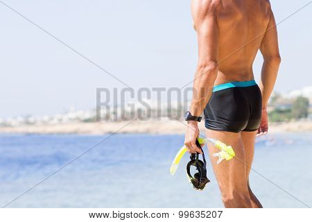 Young Strong Man Standing At The Sea Beach
