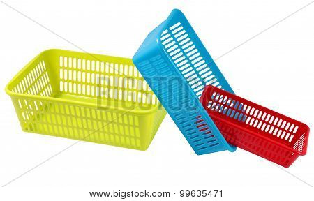 Three Colored Plastic Containers For Household Storage