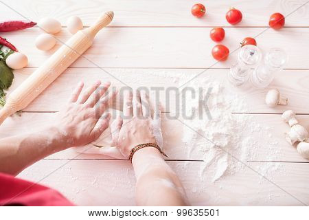 Background Of Men's Hands Knead The Dough